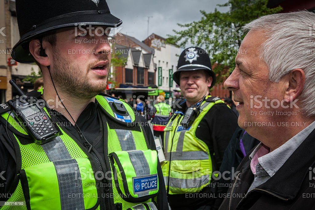 Asking a police officer a question stock photo