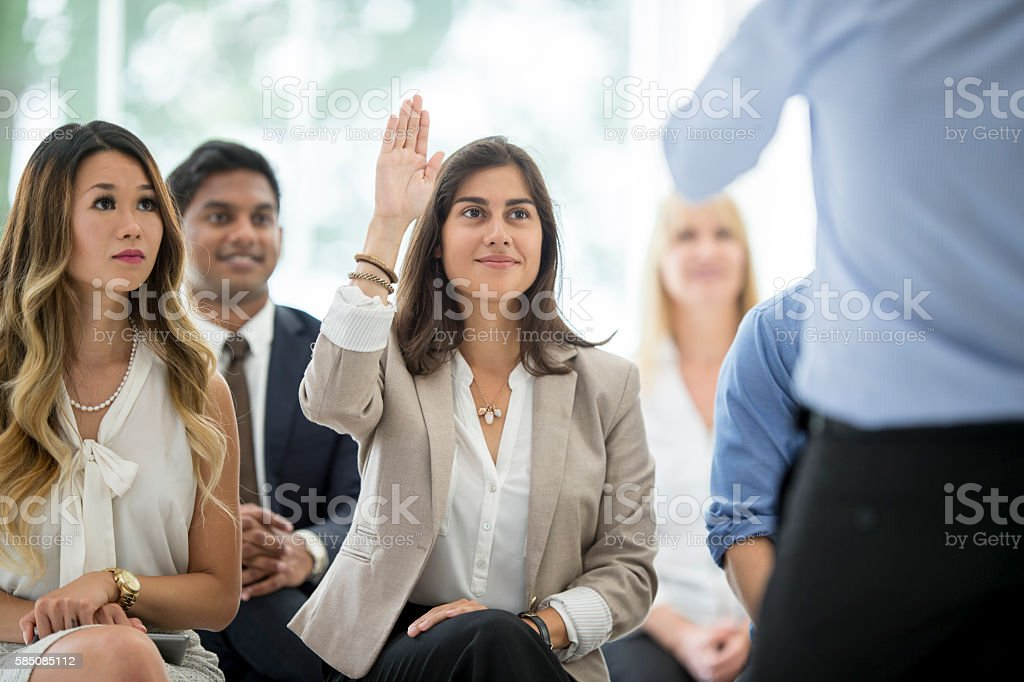 Asking a Question During a Training Program stock photo