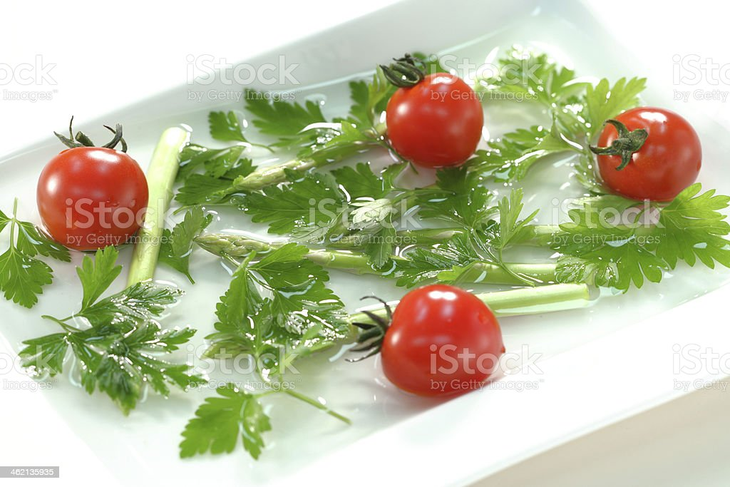 Asparagus and a cherry tomato royalty-free stock photo