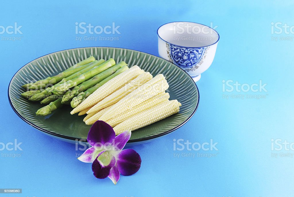 Asparagus and corn on a plate royalty-free stock photo