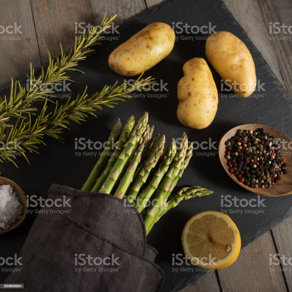 Asparagus and ingredients on a elegant linen cloth stock photo