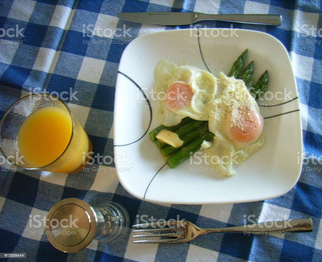asparagus and poached eggs stock photo