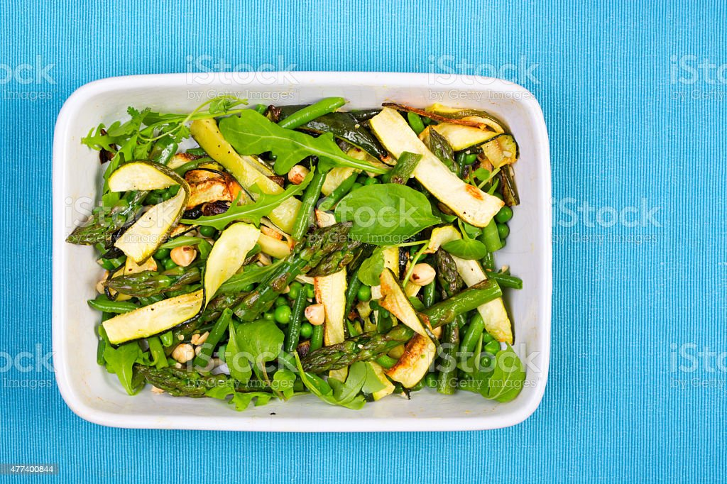 Asparagus, courgette and hazelnut salad from above stock photo