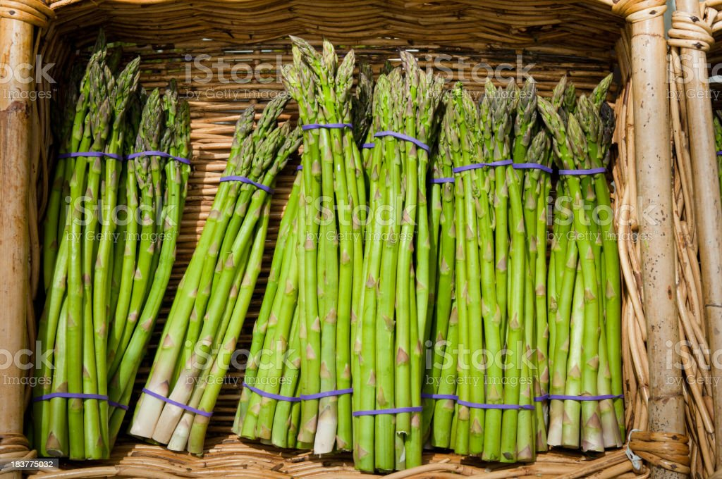 Asparagus in a basket stock photo