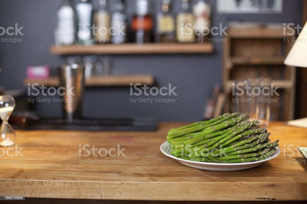 Asparagus on a kitchen counter stock photo