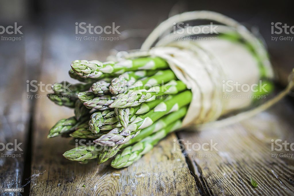 Asparagus on rustic wooden background stock photo