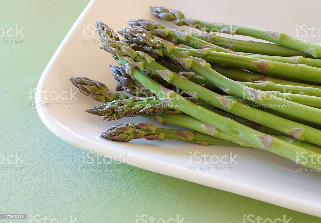 Asparagus on white dish royalty-free stock photo