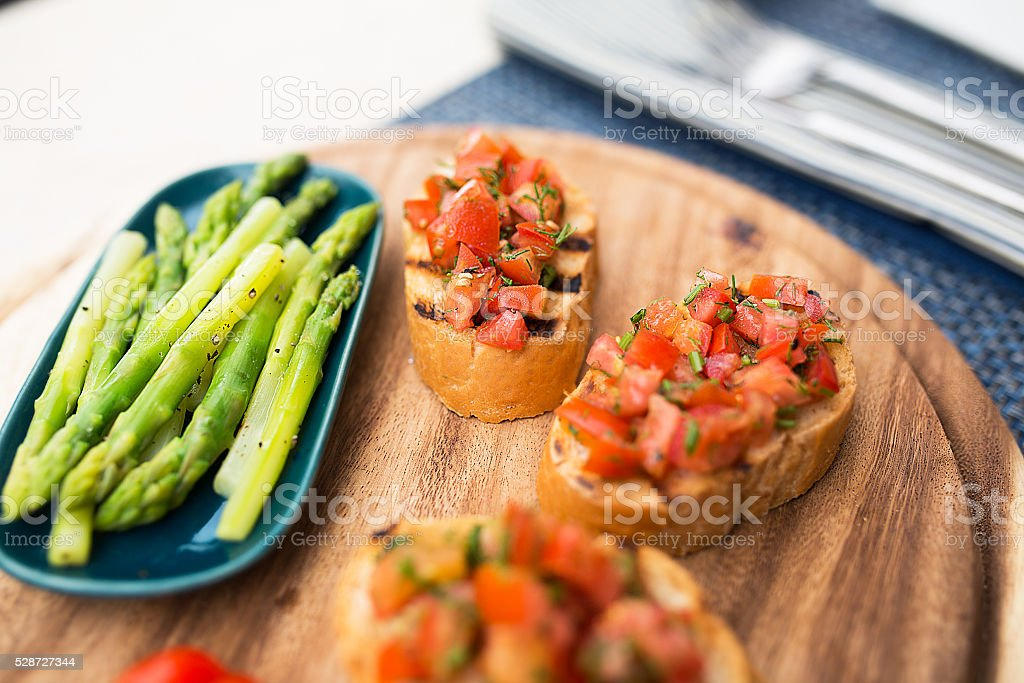 Asparagus salad witn bruschetta stock photo