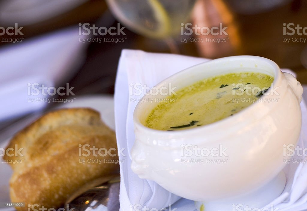 Asparagus Vegetable Cream Soup Bowl, Appetizer Bisque & Bread, Dinner Table royalty-free stock photo