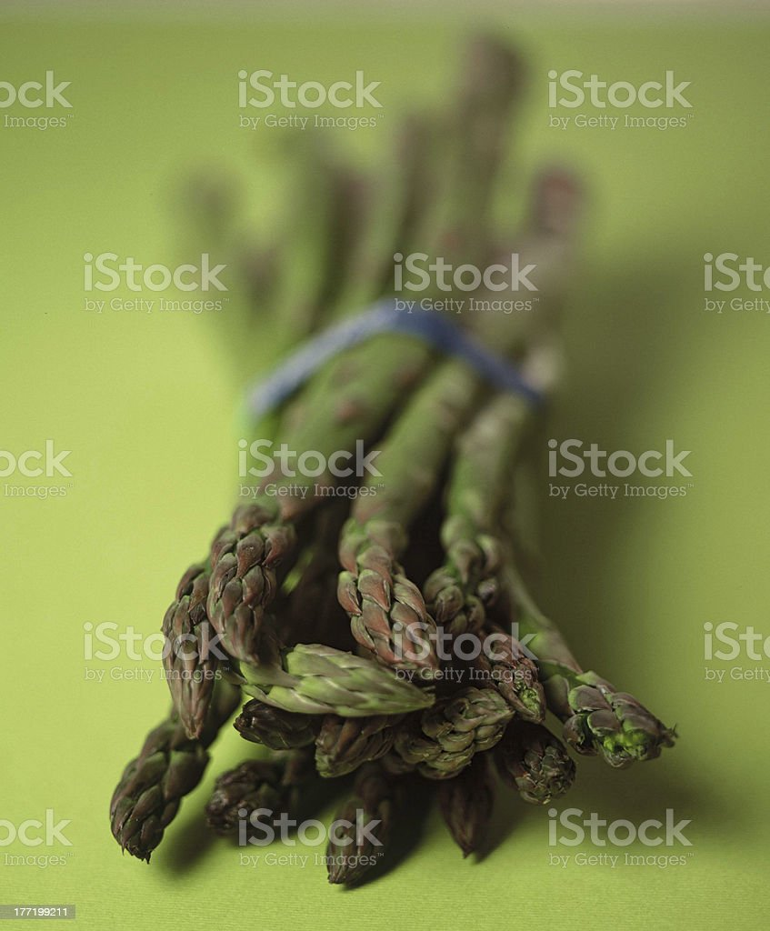 Asparagus with blue rubberband from market royalty-free stock photo