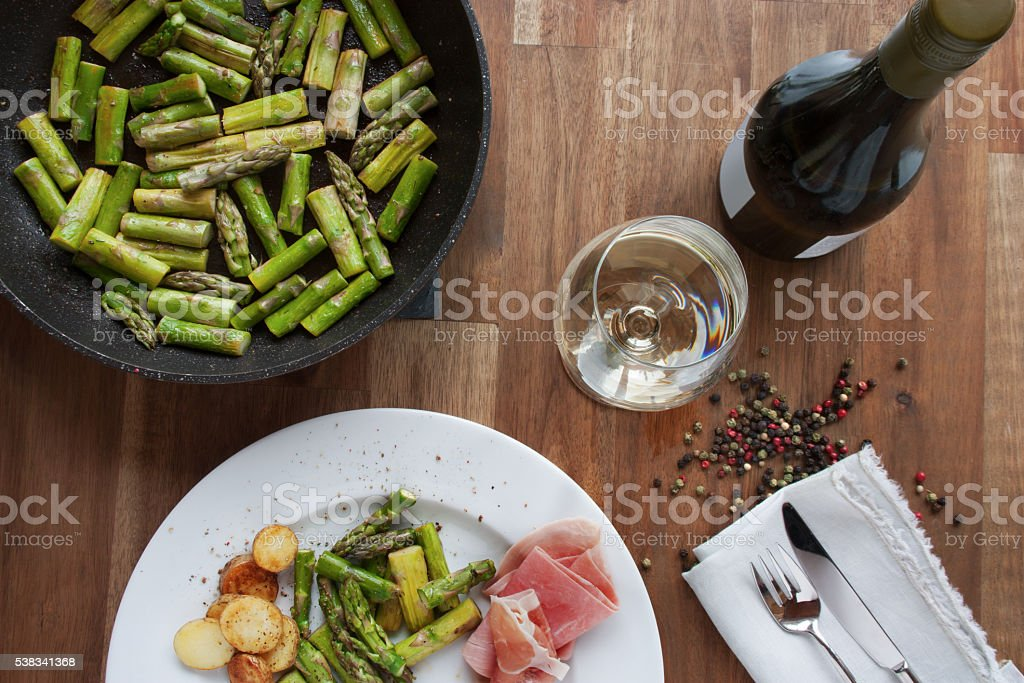 Asparagus with ham and wine stock photo