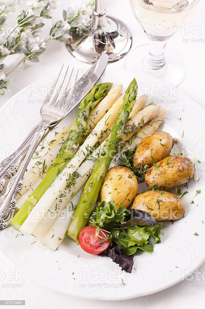 Asparagus with Jacket Potatoes stock photo