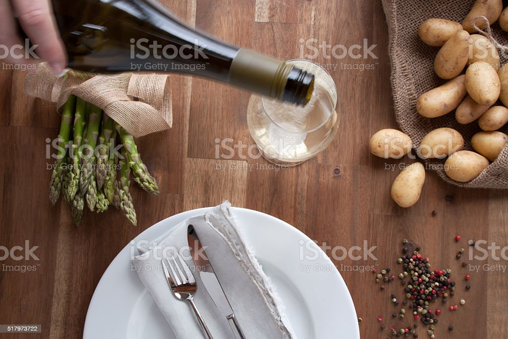 Asparagus with potatoes and wine stock photo