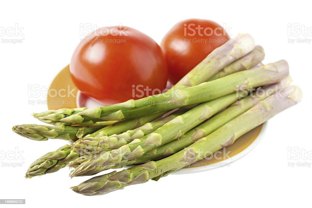 Asparagus with tomato royalty-free stock photo
