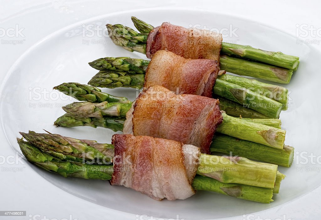 Asparagus Wrapped in Bacon. stock photo
