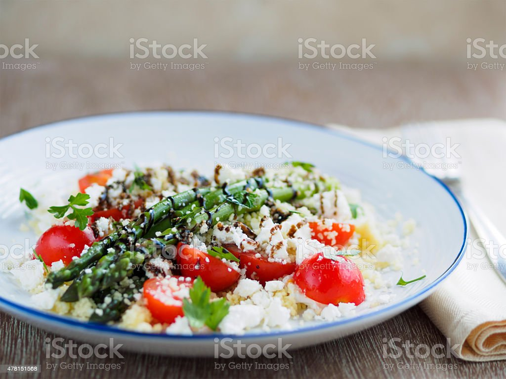 asparagus,coscous and cherry tomatoes salad stock photo