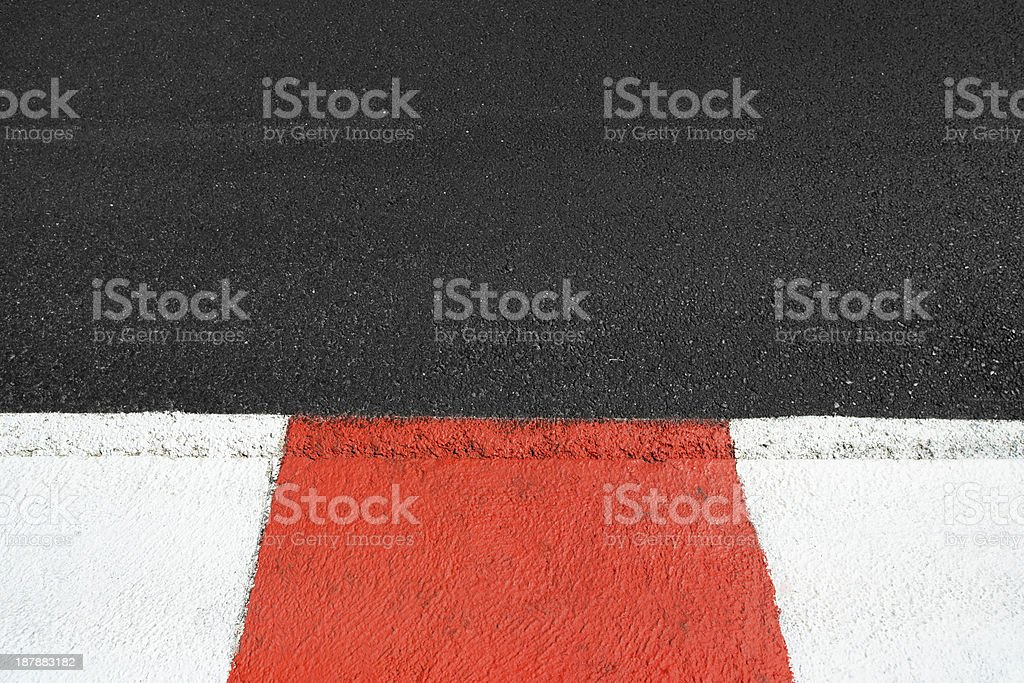 Asphalt and curb texture on Grand Prix circuit stock photo