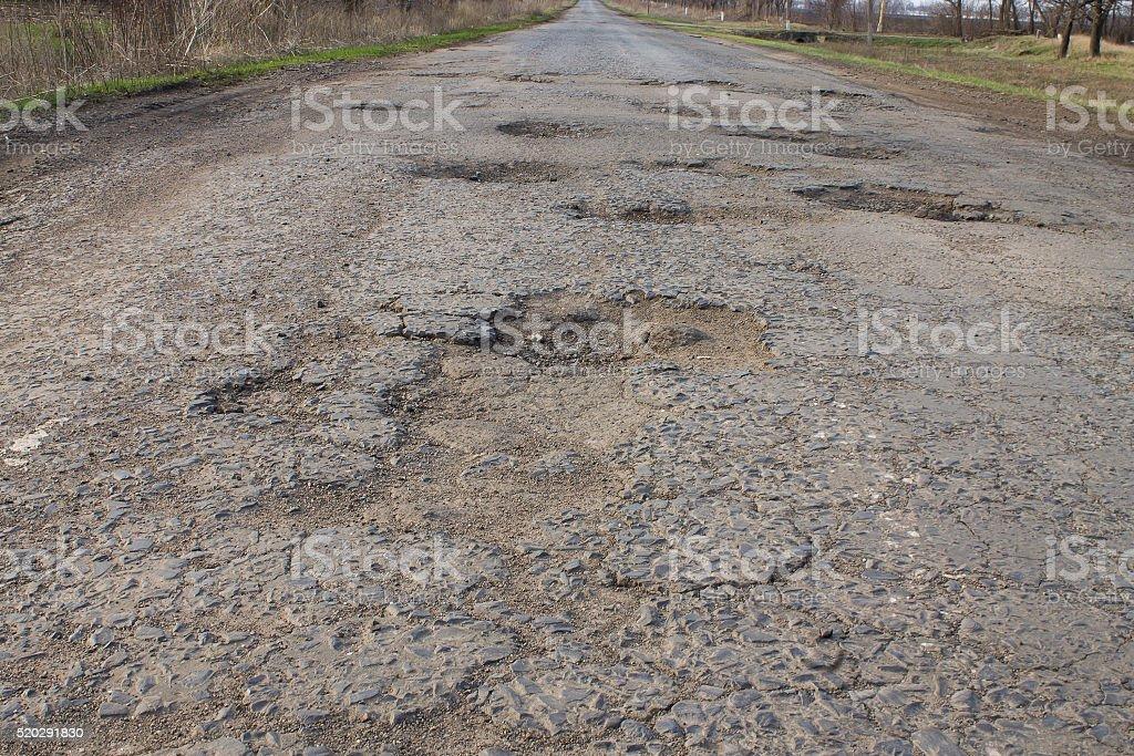 asphalt bad broken road with pits stock photo