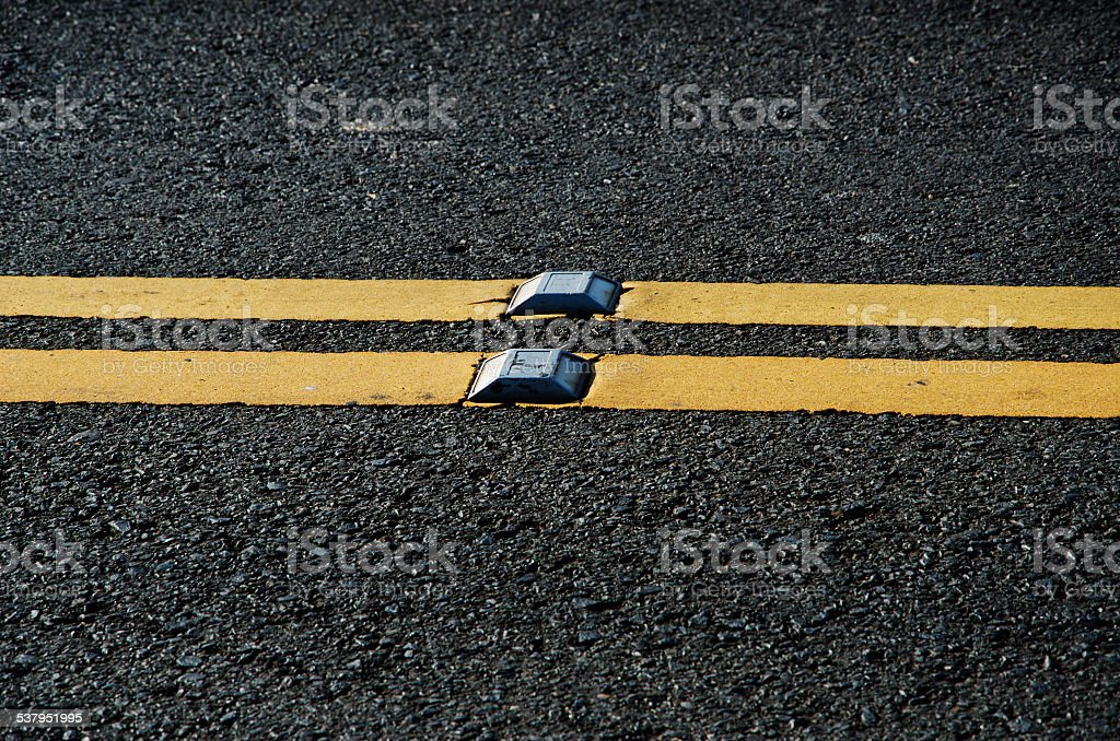 Asphalt dark texture with yellow lines stock photo