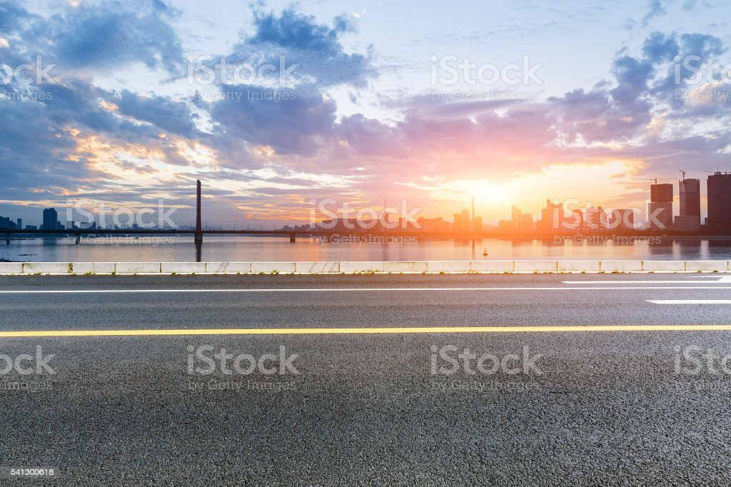 asphalt highway scenery at sunset stock photo