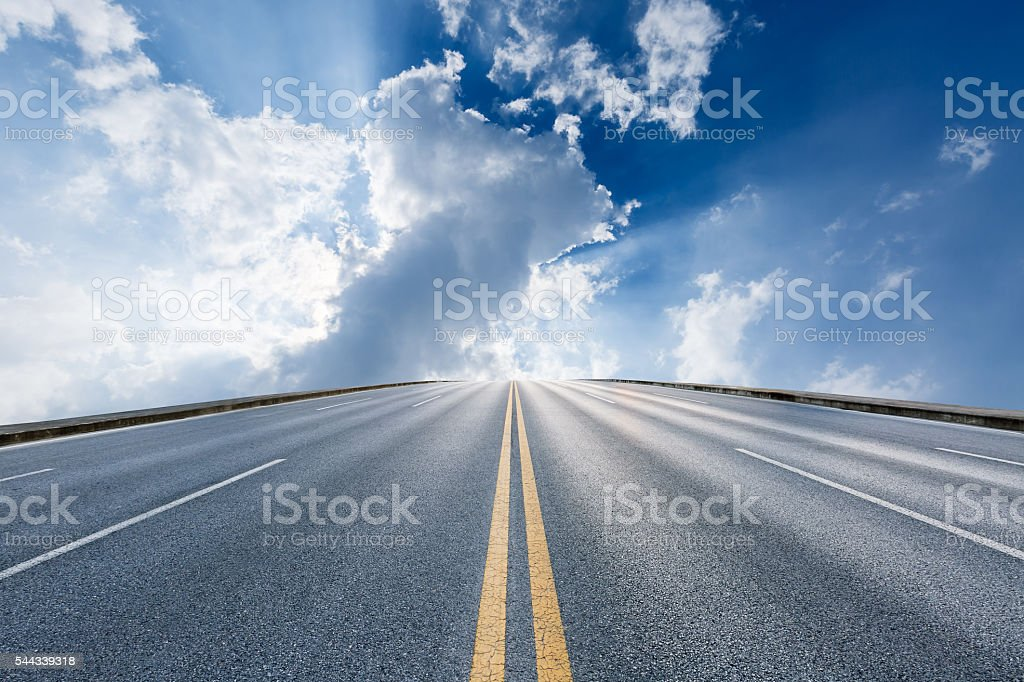 asphalt highway under the blue sky stock photo
