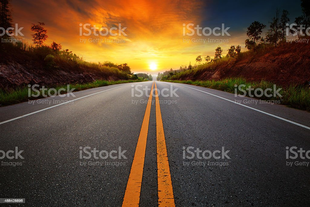 asphalt highways and sun set scene stock photo