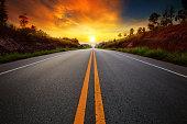 asphalt highways and sun set scene