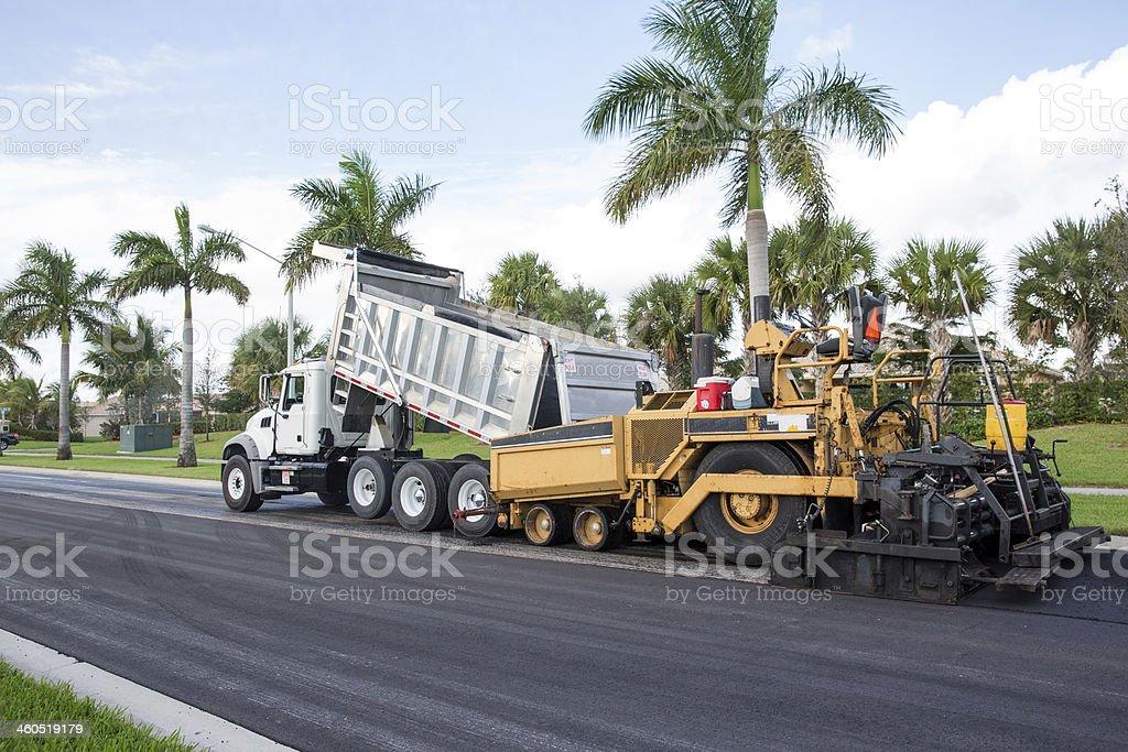 Asphalt paving machine and truck stock photo