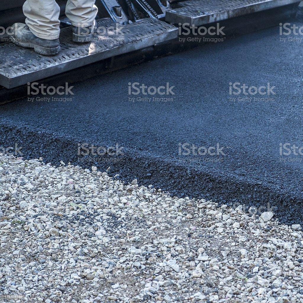 Asphalt Paving Machine Rolling Over Driveway stock photo