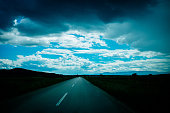 Asphalt road and clouds