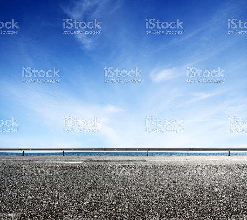 Asphalt road and sea coast line stock photo