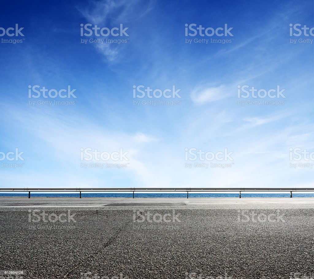 Asphalt road and sea coast line stock photo