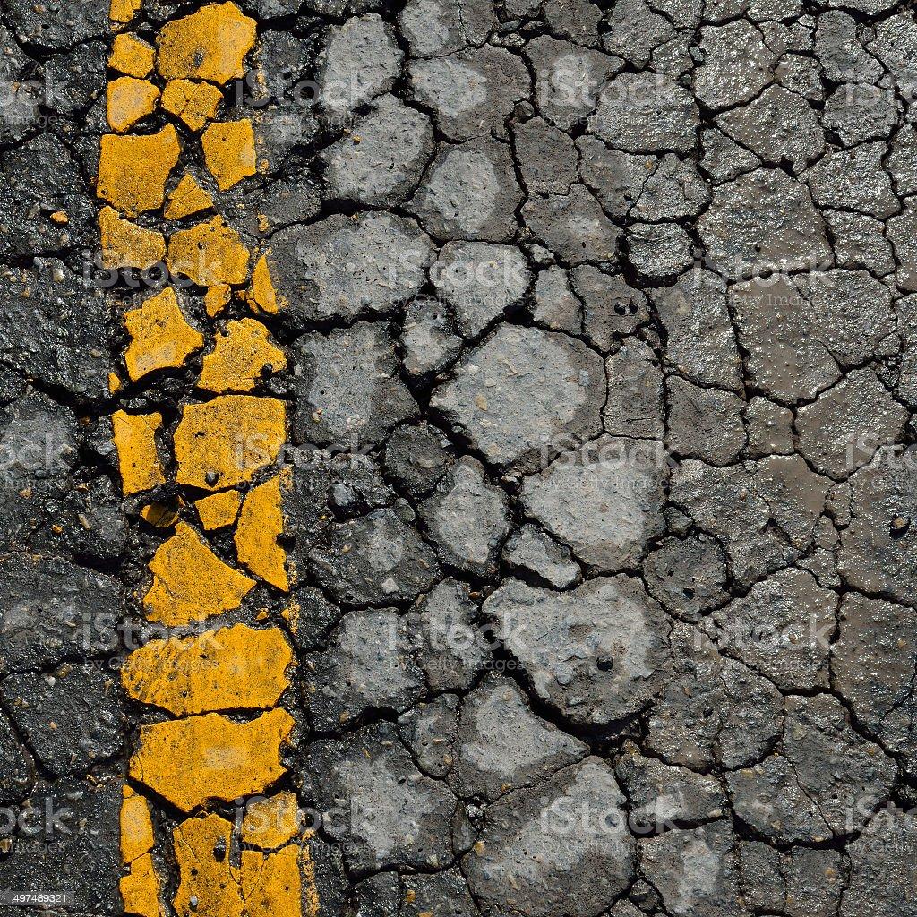 asphalt road crack texture stock photo