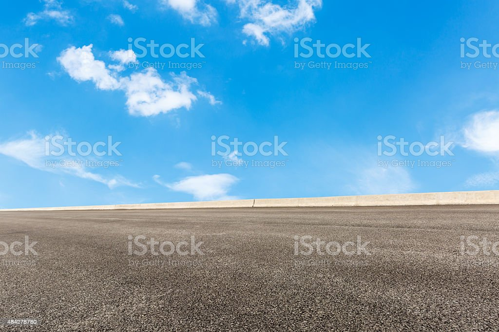 asphalt road in front of the blue sky stock photo