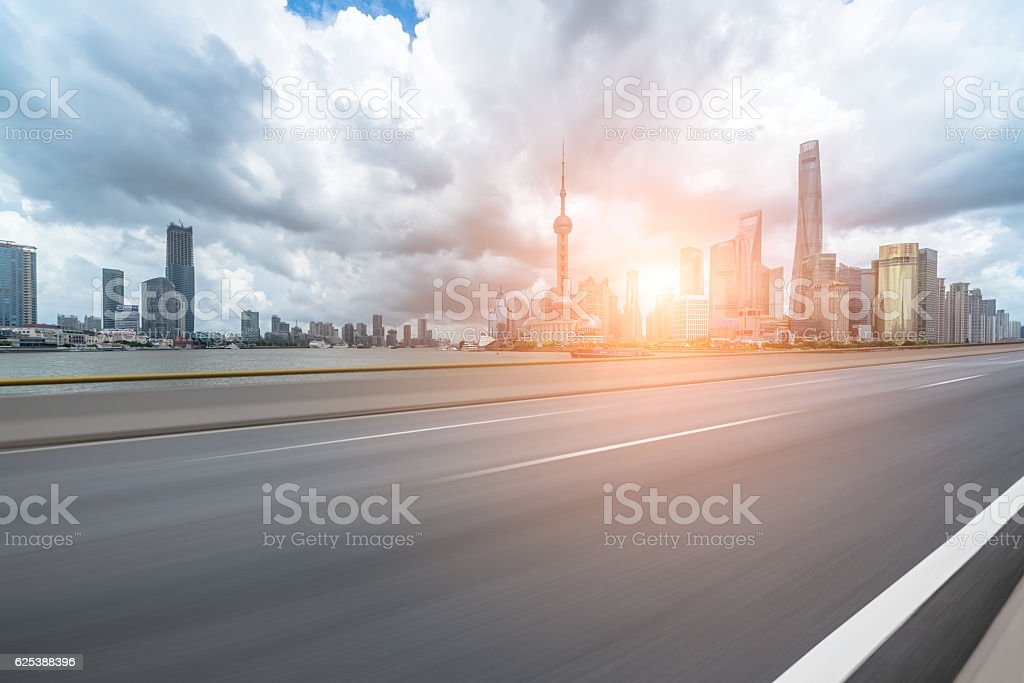 Asphalt road in front of the modern city Shanghai china stock photo