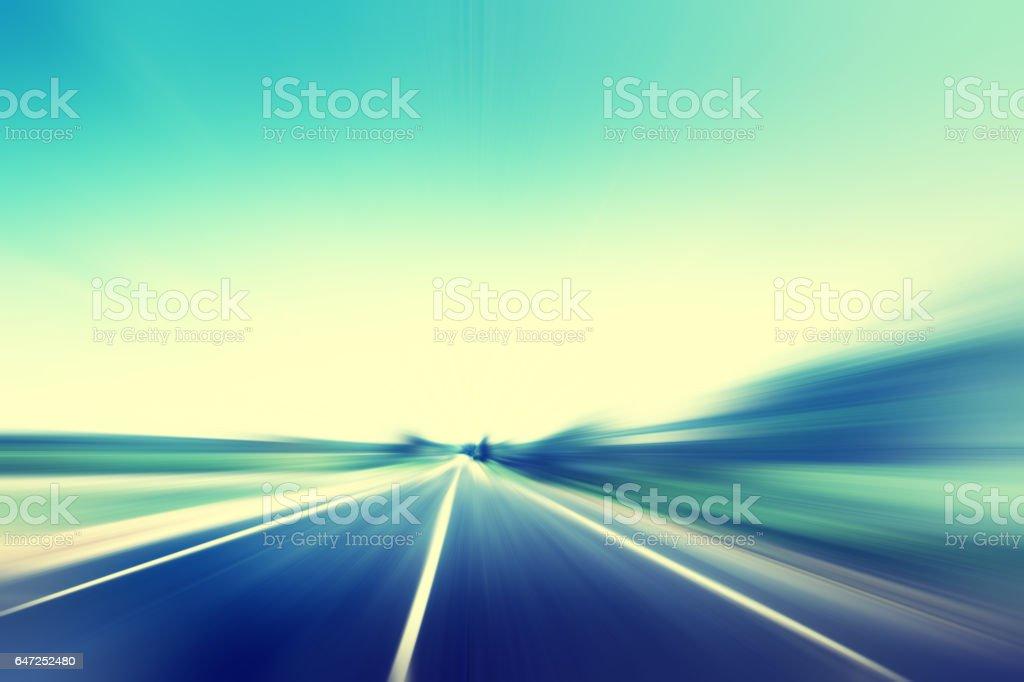Asphalt road in motion blur. Vintage style. stock photo