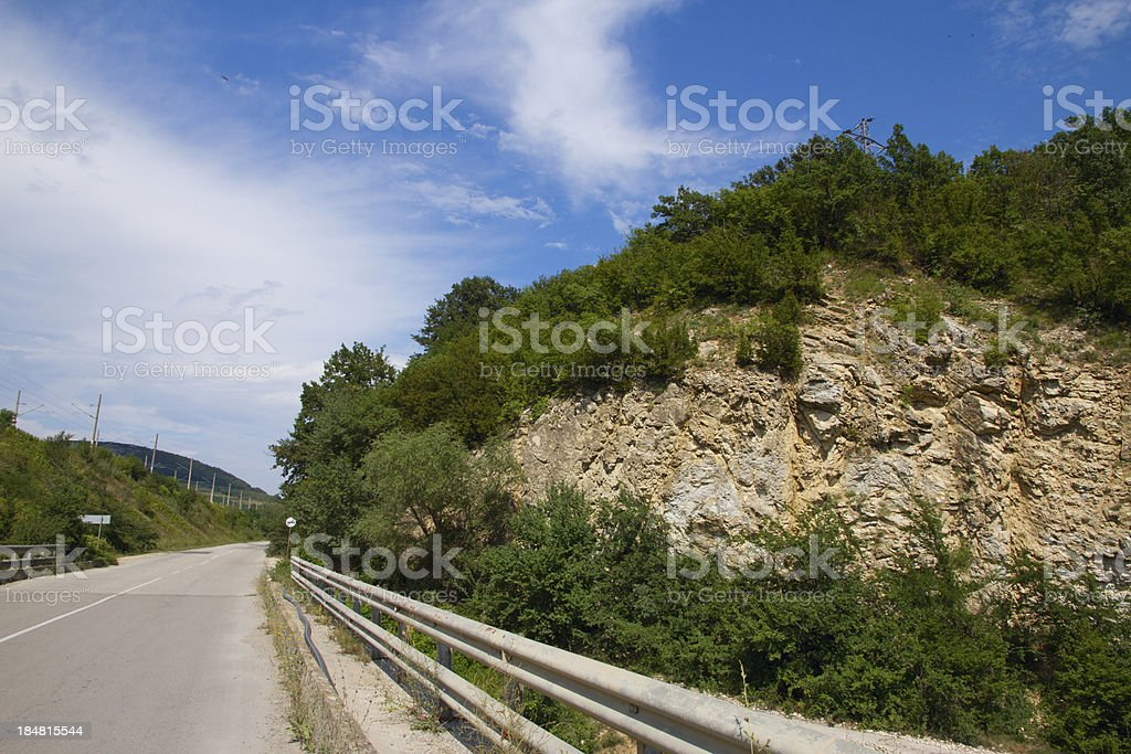 Asphalt road in mountains against the blue sky royalty-free stock photo