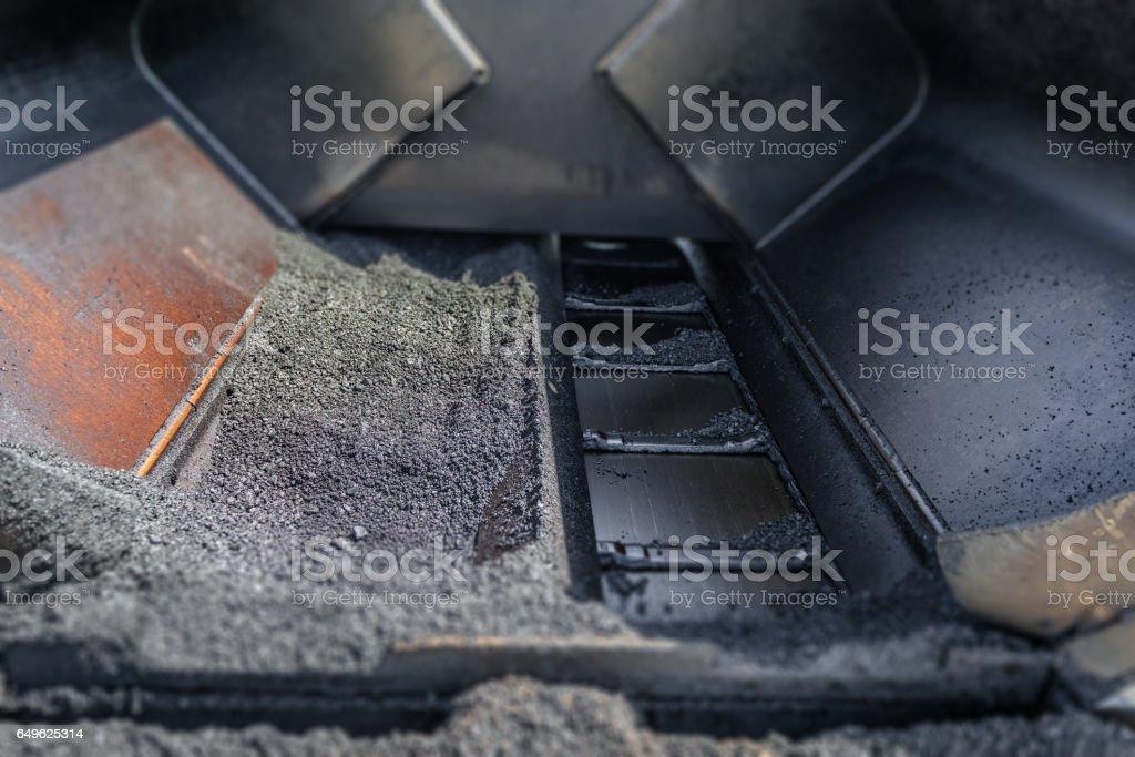 Asphalt road paver paiving machine closeup construction industry stock photo