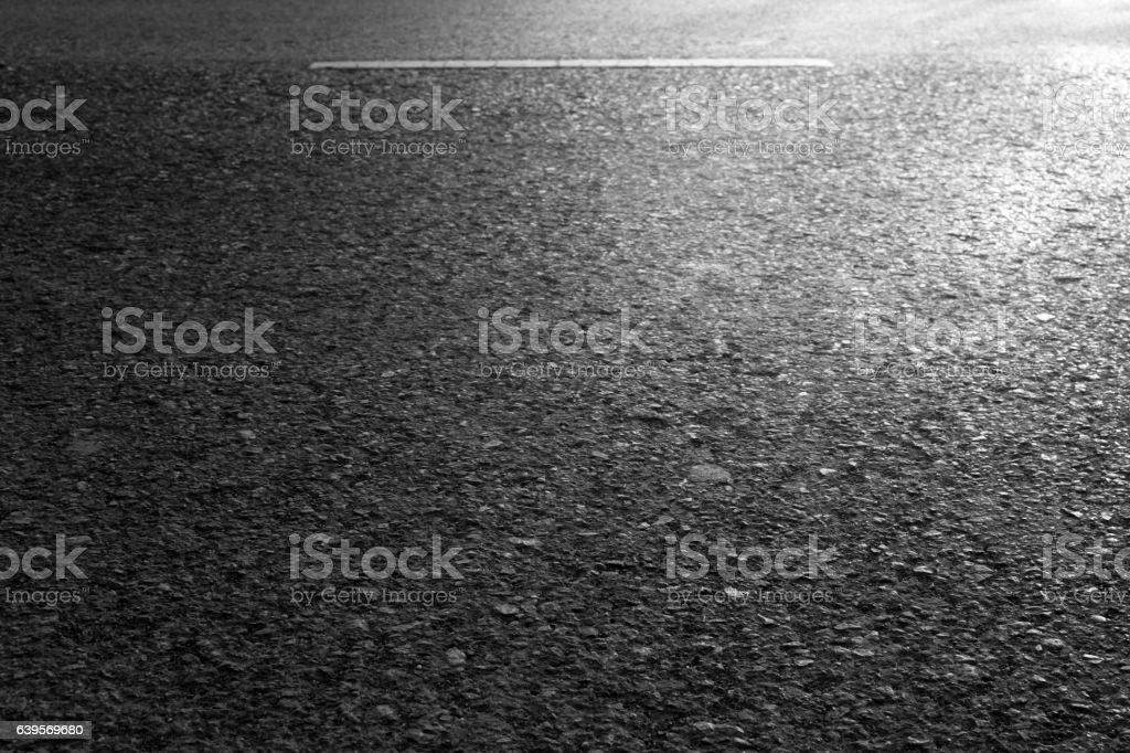 Asphalt road textured closeup background. stock photo
