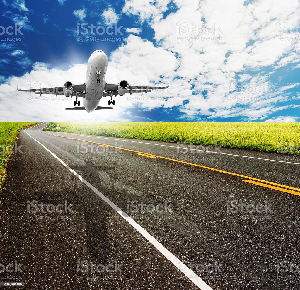 asphalt road through the green field stock photo
