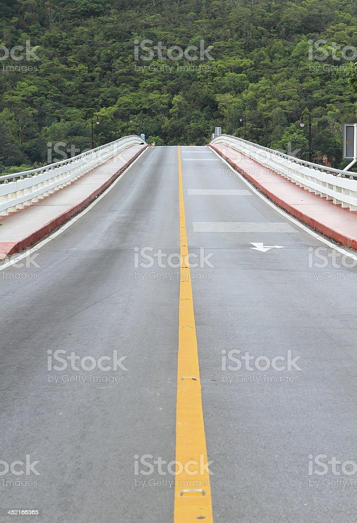 asphalt road to far away stock photo