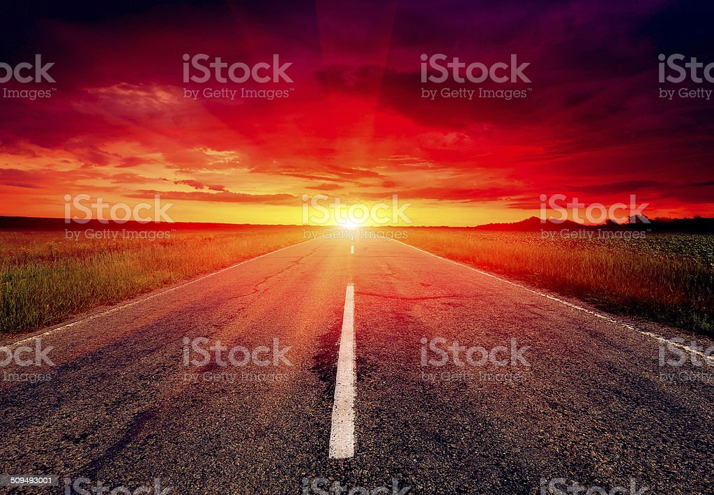 asphalt road to sunset stock photo
