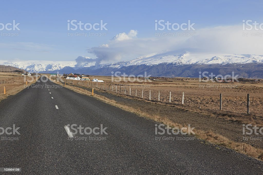 Asphalt road to Volcanic eruption in Iceland stock photo