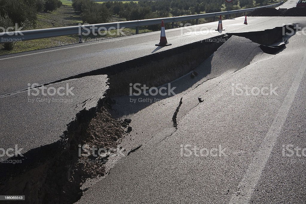 Asphalt road with a crack caused by landslides stock photo