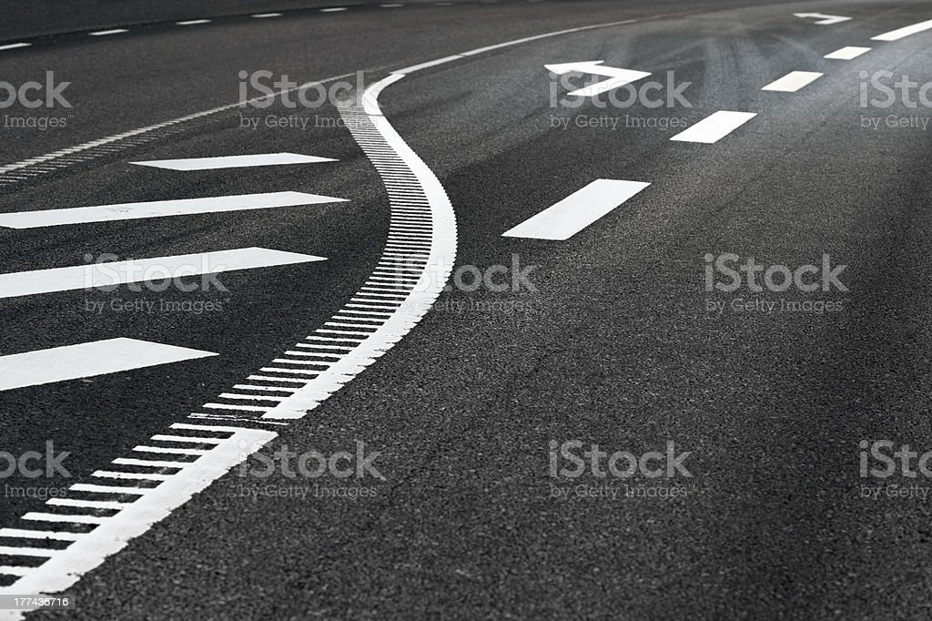 Asphalt road with arrow sign royalty-free stock photo