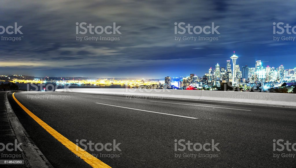 asphalt road with cityscape of seattle at night stock photo