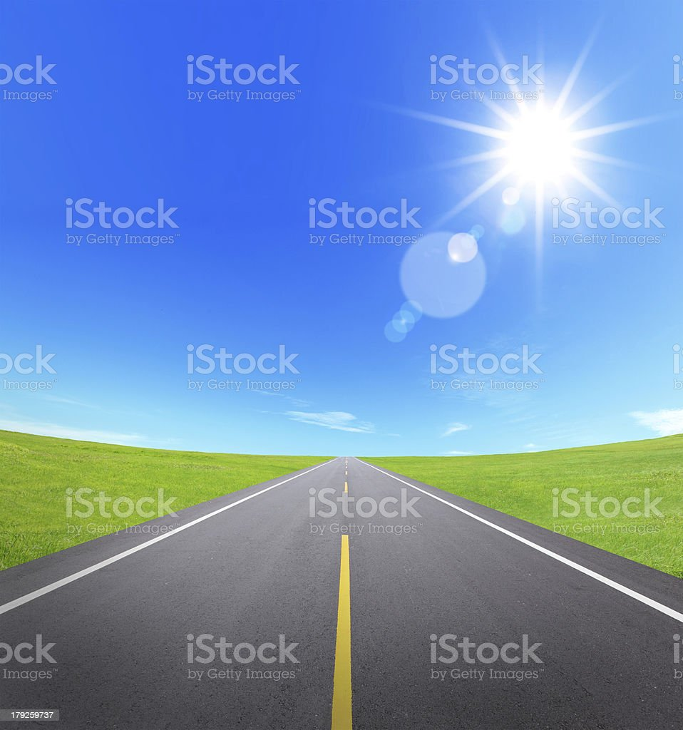asphalt road with cloudy sky and sunlight royalty-free stock photo