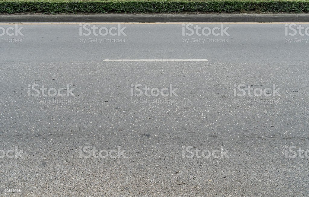Asphalt road with concrete curb stock photo
