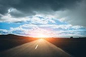 Asphalt road with sunset
