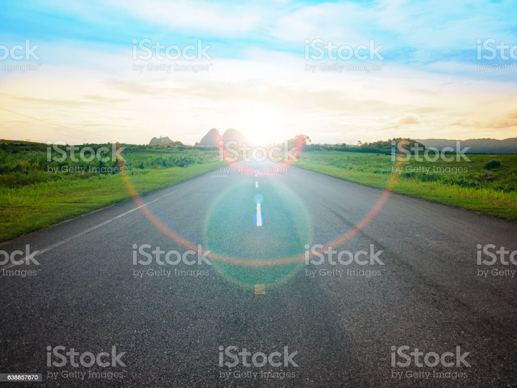 asphalt road with yellow blue sky background stock photo